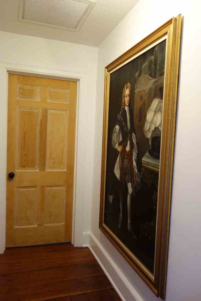 Painting hung outside bedroom door