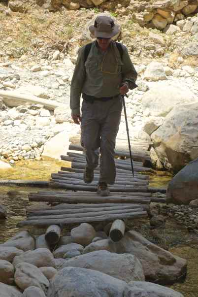 In the narrow canyon we walked along and crossed the river several times on wooden bridges.