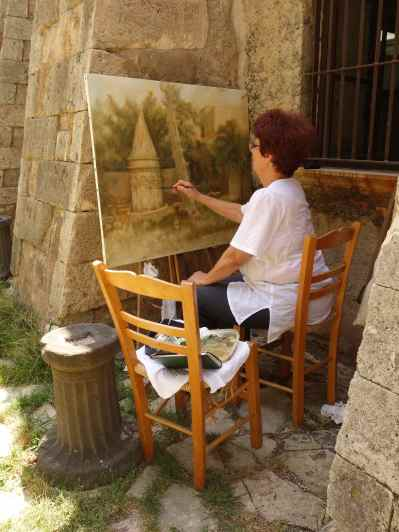 A painter worked in the quiet courtyard as we left the museum.