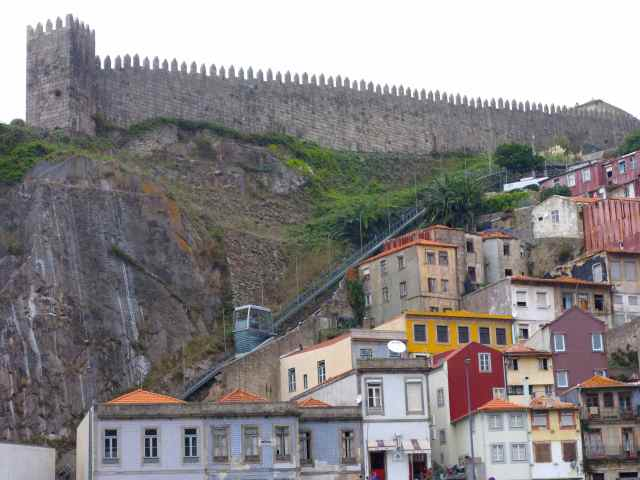 The old city wall in the background. Can you spot the funicular bringing passengers down the steep hill?