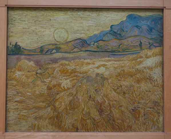"The hills are in the upper right corner of ""Wheat field with reaper and son"", Vincent van Gogh, 1889"