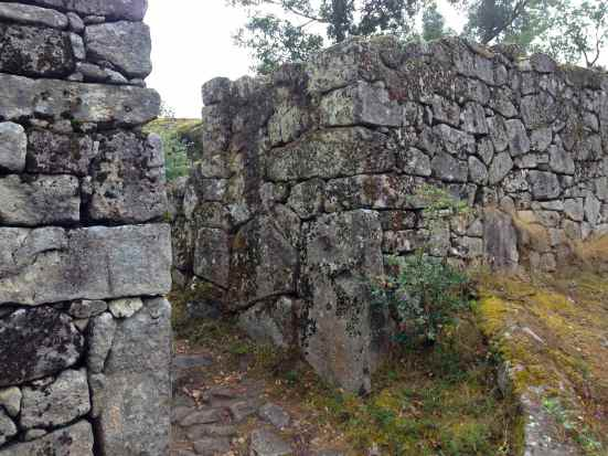 The stone wall is 1 meter thick with few breaks in the rampart.
