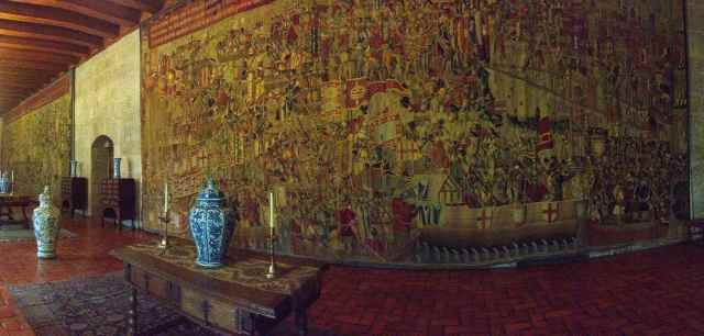 Wall-sized tapestries hung in the receiving rooms. Most everything in the palace appeared to have been restored.
