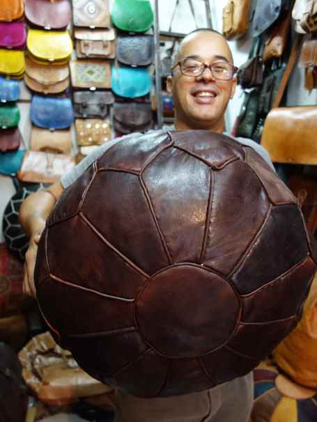 Handmade leather pouffs for sale at Merzoga Cuir: Leather Shop