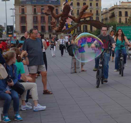 The bicycle rider managed to avoid the bubble in his path.