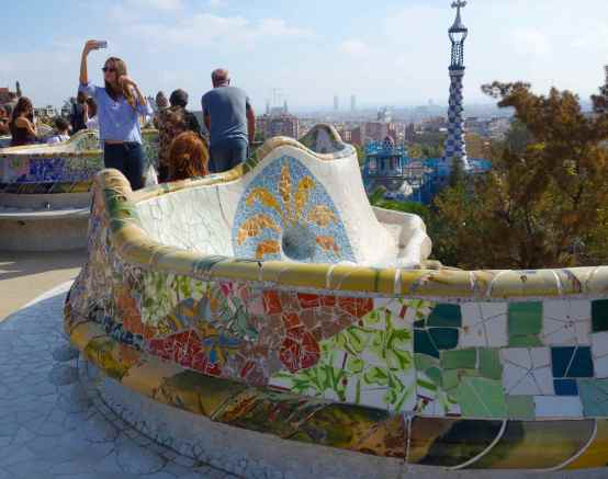 We took stairs up to a large open plaza with a serpentine bench ringing the exterior. We visitors gathered for the view and to sit on the tiled bench.