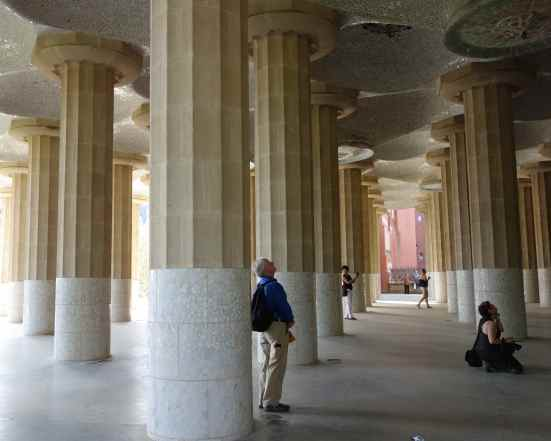 We walked back down steps to discover what was holding up the bench and part of that open plaza where we'd just been: massive columns with tiled mosaics on the roof.