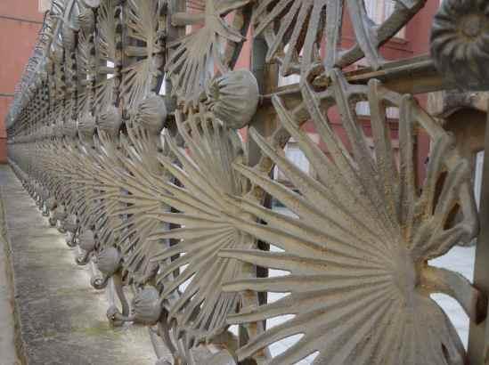 A fence becomes a decorative garden art-piece.