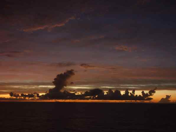 When the sun had set, we continued to walk laps around the deck. After a few rounds, we saw that deeply colored clouds appeared in the darkening sky.