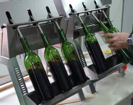 Wine flowed into each bottle