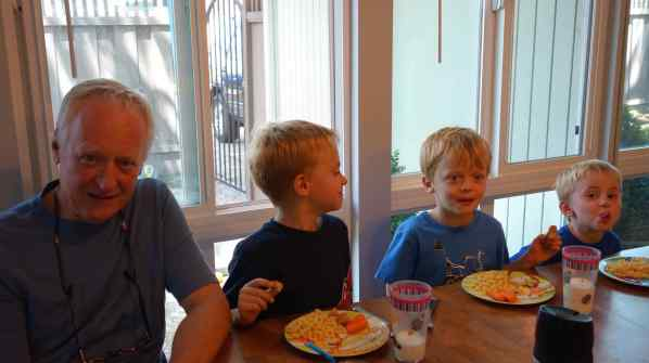 Relaxed dining with three young boys