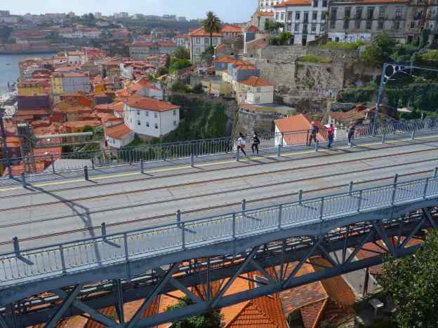 Everyone walks in Porto, Portugal. We strolled a few minutes from our AirBnb and then climbed to the top of the ancient city wall – the perfect place to photograph the bridge and river scene below.