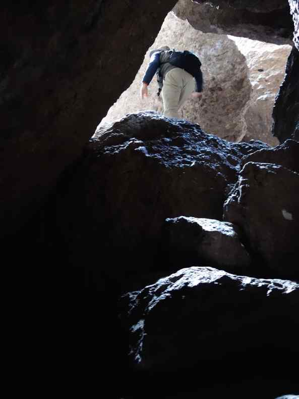 After more climbing over and around the rocks, Joe scrambled out first into the light.