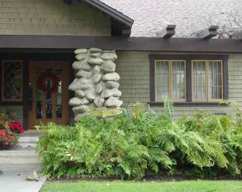 Craftsman style is characterized by porches, stone details, paned doors, multi-paned windows, earthy colors.