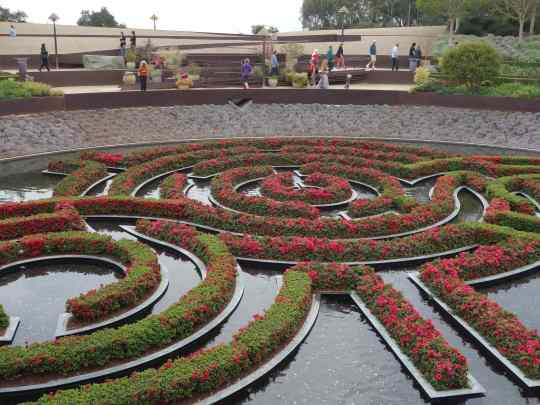 Zig-zagging pathways dropped into the garden with the centerpiece water feature always in view.