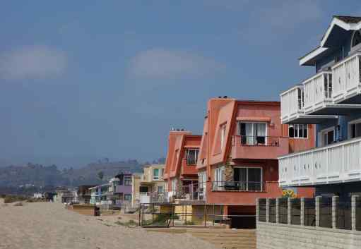 After lunch we walked one block down to the beach in Ventura.  With shoes off and feet in the sizzling sand, we walked by the colorful buildings to the Pacific Ocean.