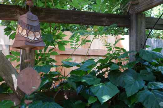 Jeannie hung a bell in the midst of greenery draped over the trellised arbor.