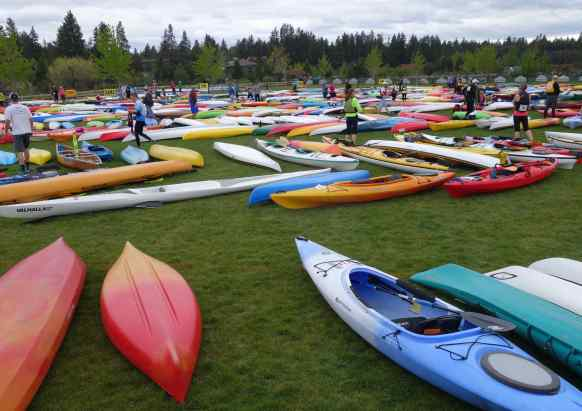 The kayaks littered the field, awaiting the runners to arrive to claim their own, carry it a short distance to the Deschutes River, and set off paddling down the river.