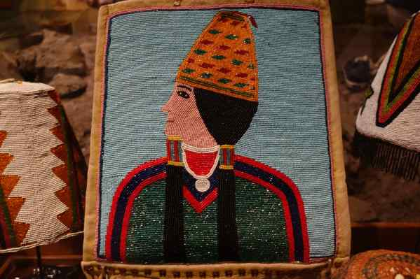 "The sign read ""The basket hat distinguishes Plateau culture…Basket hats are revered family heirlooms and may be passed from mother to daughter, carrying tradition with them…The beaded portrait is from the Umatilla Reservation."""