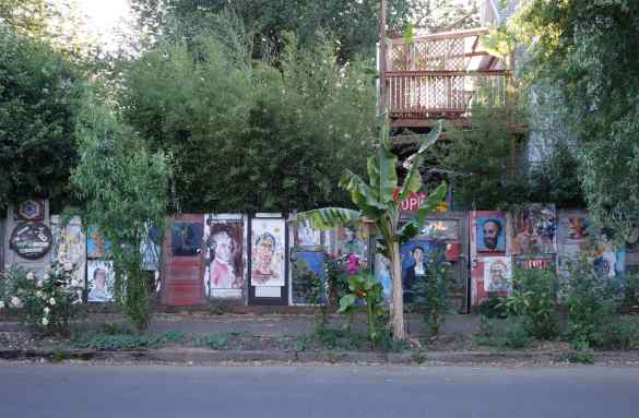 Paintings graced the wooden fence around a house. Our favorites were the historic portraits.