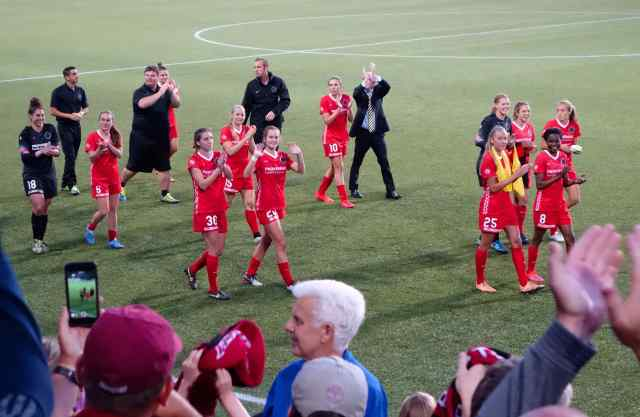The Rose City crowds went wild, cheering as the team took a walk around the field at the end of the game. The goalie, Michelle Betos, is at the far left of the photo (number 18 and dressed in black).