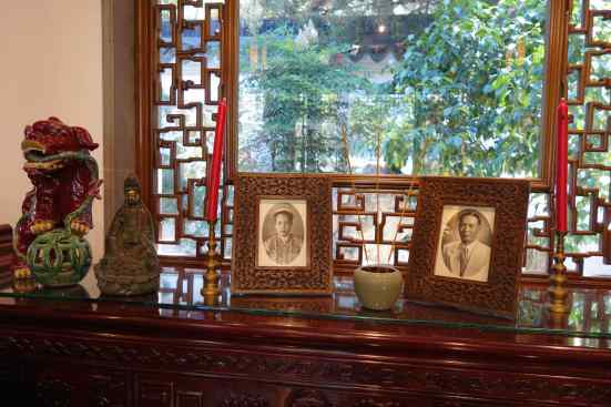 The portraits of Madame Choong Boo Siew and Mister Toh Hooi Choon, the great-grandparents of a garden staff member, were surrounded by joss sticks and candles. We weren't surprised to see the altar for remembrance and to honor departed family – often found in Chinese homes.