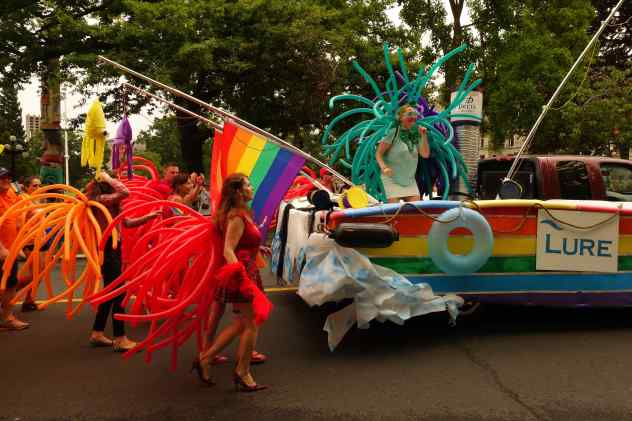 Groups strutting down the parade route in the most wonderfully conceived outfits