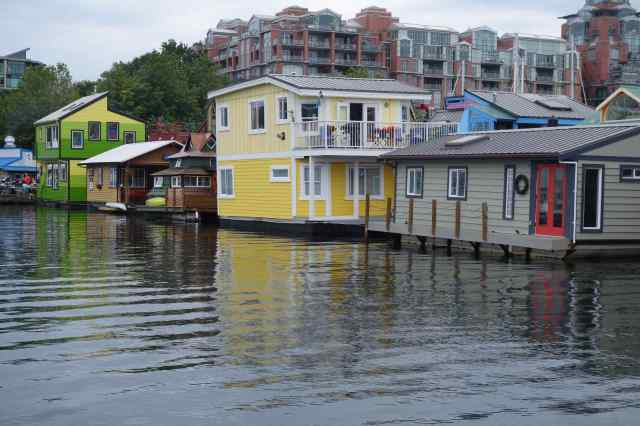 The high-rise apartment dwellers have a great view of the houseboats; but sadly, the houseboats' view of the apartment building isn't quite so nice.