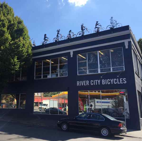 """..and only a few blocks away the metal """"bikers"""" on the roof are ready to soar off into thin air."""