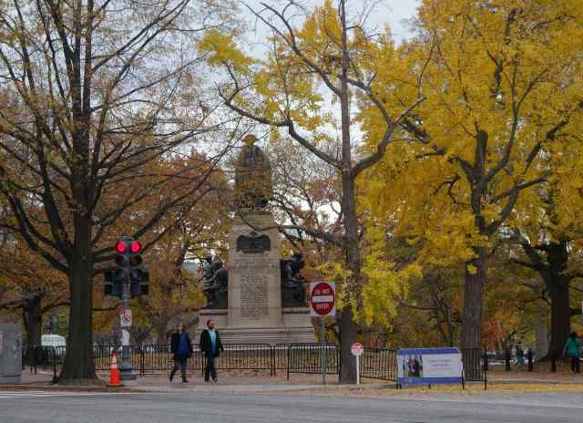 Connecticut Avenue ends in Lafayette Square at the statue of Casimir Pulaski, who fought with those seeking independence in the Revolutionary War. The square borders the White House, almost visible through the trees.
