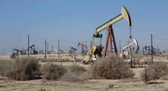 Right next to a California vineyard arose a field of oil wells.