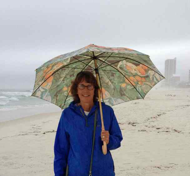 That rain jacket has traveled in Beth's suitcase across the United States and all over the world. (This is a photo from three years ago on a beach in Florida.)