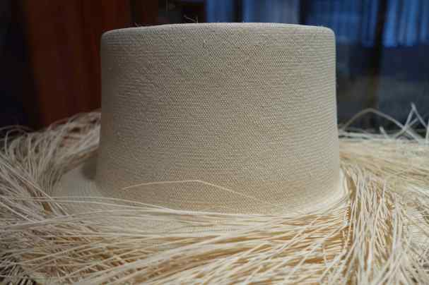 The guide showed us a higher quality hat to better understand the weaves per square inch and uniform weaving. The finest hat might have up to 3,000 weaves per square inch.