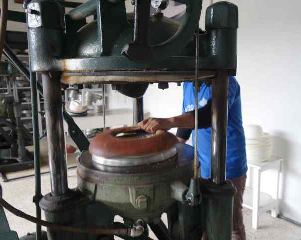 Hats are blocked by placing them in a mold and a hot, hydraulic press turns them into the desired shape.