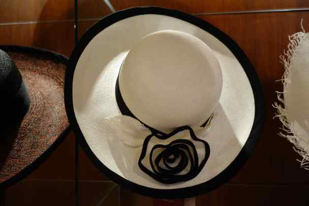"""While we were focused on the men's classically styled hats, we noted that Homero Ortega makes 85 different hat styles, 500 hats every day, and not all look like the classic """"Panama hat"""". We also saw woven bags and a finely woven wedding dress (amazing!)."""