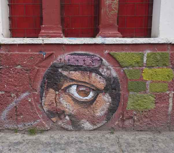 We loved this painting, found on a small building. Was it a house or shop, and was the work graffiti or commissioned?