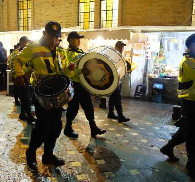 A police band followed the procession, and the bystanders fell in after them to walk towards the Cathedral.