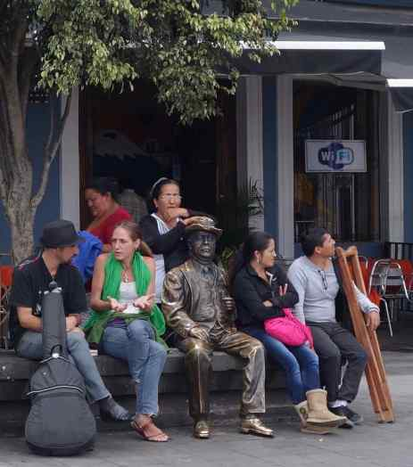 We strolled through the plaza by Quito's National Theatre and saw others resting on the bench.