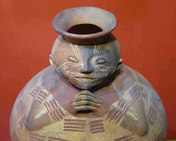 This piece was from the mountainous areas of the Cosanga or Panzaleo civilizations, where the principal occupation was growing corn and yucca. The full cheeks on many of the ceramic figures are from chewing coca leaves. 500 BCE - 1550 CE