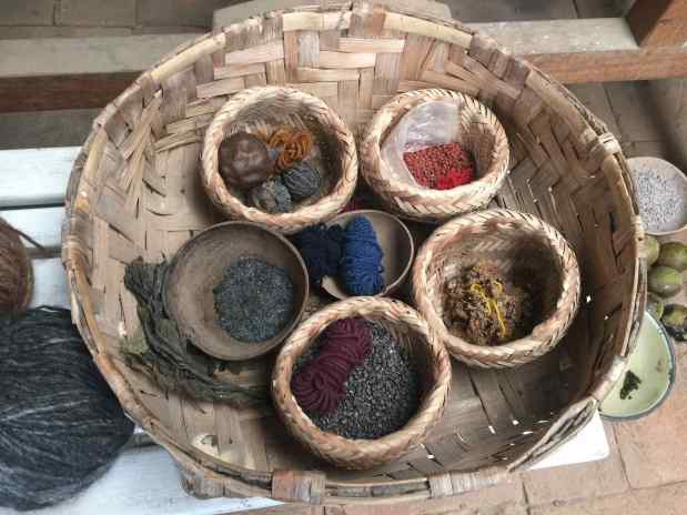 The natural dyes are walnut for brown, Indigo for blue, cochineal (a bug) for red, lichen for yellow, and chilco (a wild fuschia) for purple.