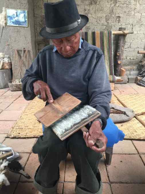 Miguel carded the wool several times, each time with a progressively finer-grade carder. In the past, thistles were used before carders.