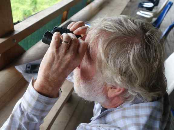 Cousin Tom monitored the gathering birds in hour three of our wait.