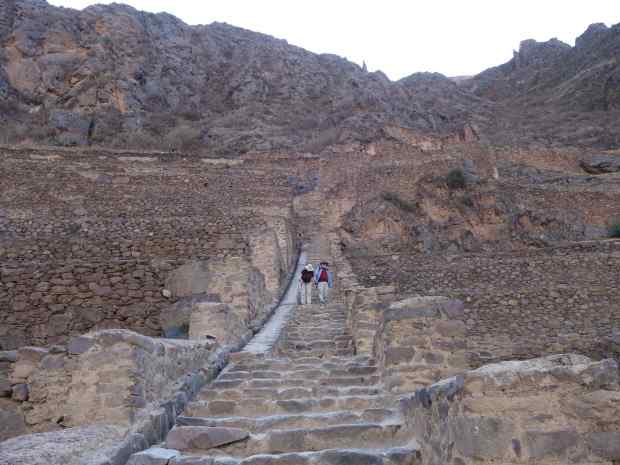 Cousins Susie and Tom descending one of the grand staircases from possibly the Funerary section of the Temple section.