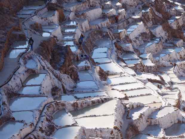 The salt pans have been in use since before the Incas came to power. Each local family can ask for their own salt pool. At some distance we watched one family raking their pool.