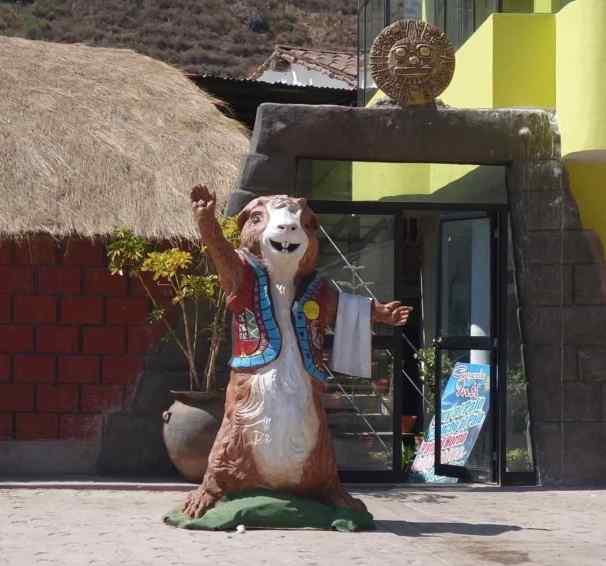 "On our drive through the Sacred Valley, we passed a small town with several ""fast food"" stops for their signature dish, cuy (guinea pig). We didn't stop to eat, but loved their statue."