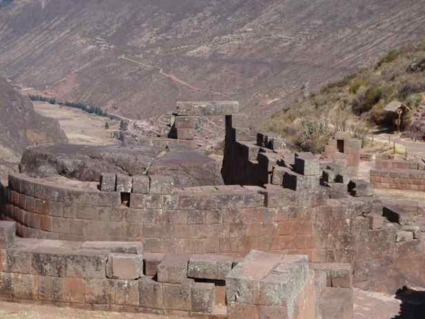 "A curved wall wraps around a giant rock. This is the Sun Temple featuring an Intihuatana, or ""the sun´s hitching-post"", a sundial that tracked the Inca's astronomic calendar."