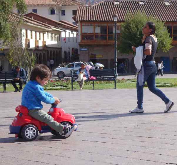 No one was having more fun than this tyke riding his shiny red car.