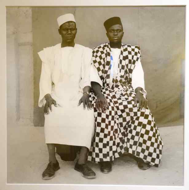 Maiga's portraits were black and white. People came to his studio, dressed to have their photos taken.