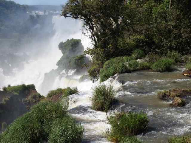 """We spent two days working our way from one viewpoint to the next on the Argentinian side of the Falls. Every time we got to an overlook, we """"ooh'd"""" and """"aah'd"""" over the amazing sight of huge volumes of water plunging over the falls. The sound was a constant roar, and we had to shout to each other to be heard."""