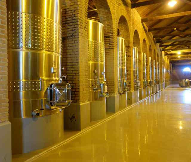 The 2nd winery we visited, Bodega Terrazas de Los Andes, was in every way larger.  It ferments wine in stainless steel vats, some as large as 100,000 liters (11 times the size of Benegas' concrete tanks). Their production is 3 million bottles a year.